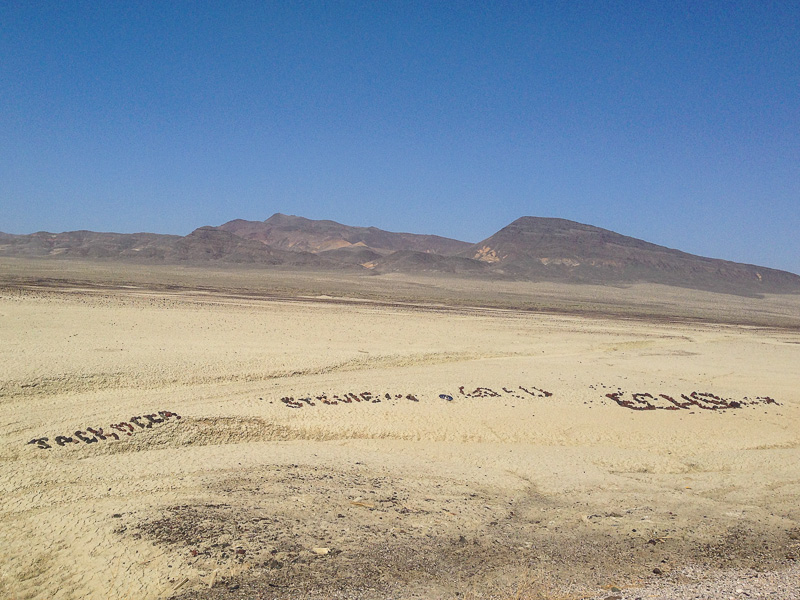 Rock messages lined the highway for miles in the Salt Wells Basin