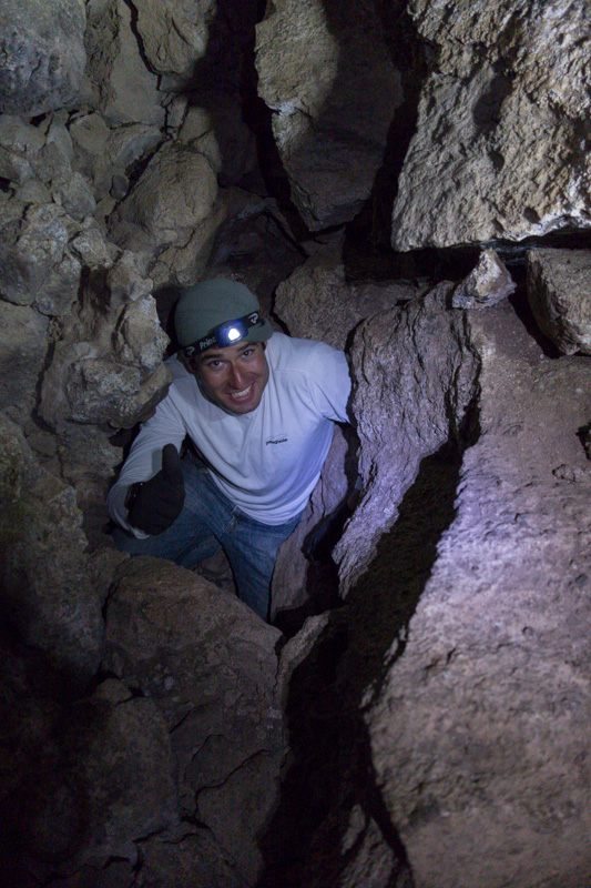 Tammer climbing up through the hole