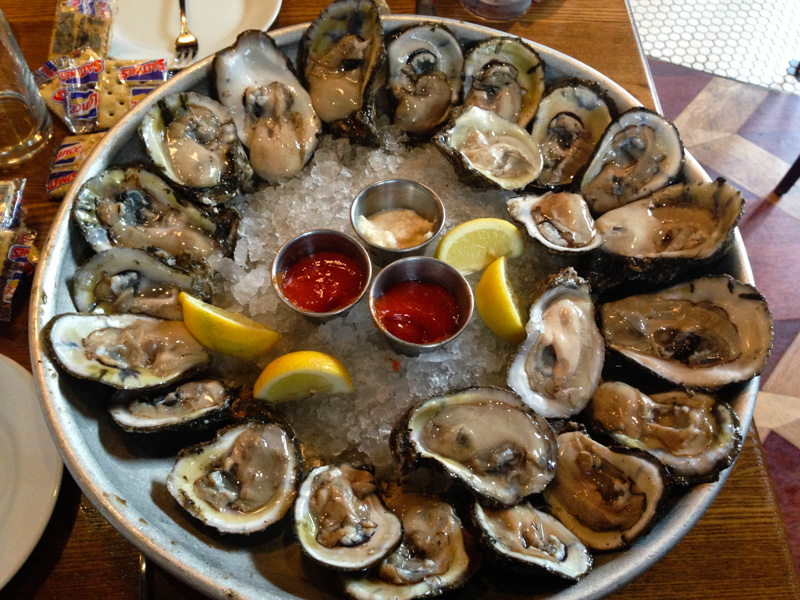 2 of the 3 dozen $0.50 oysters